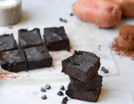 image of brownies on white background with sweet potatoes and cocoa powder