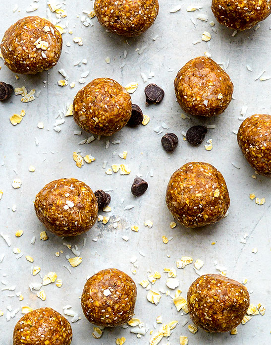 close up cookie dough energy bites with oats and chocolate on tabel