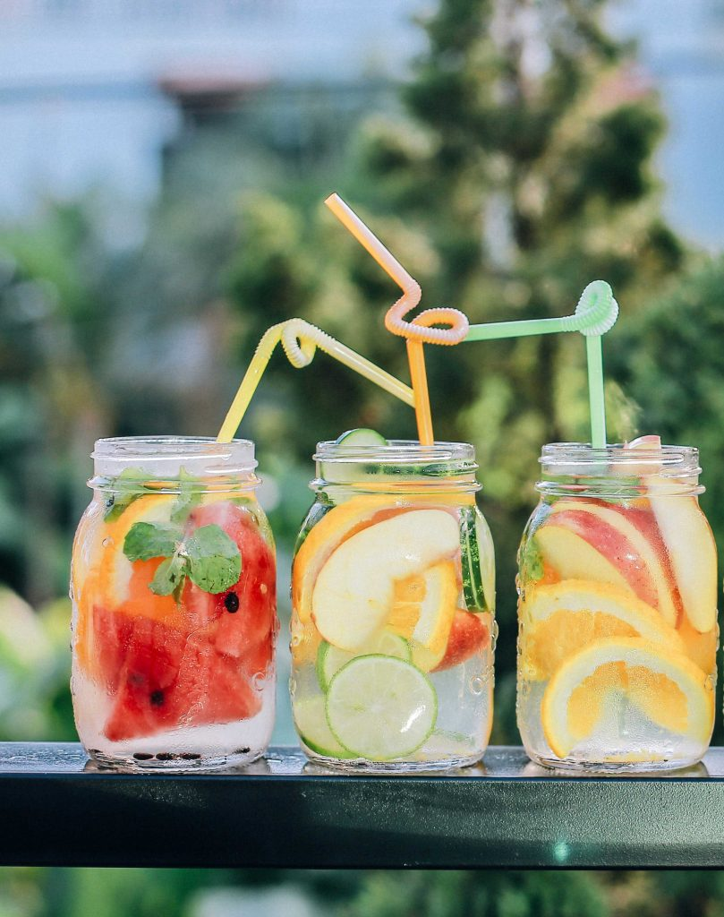 glass mason jars with water and fruit