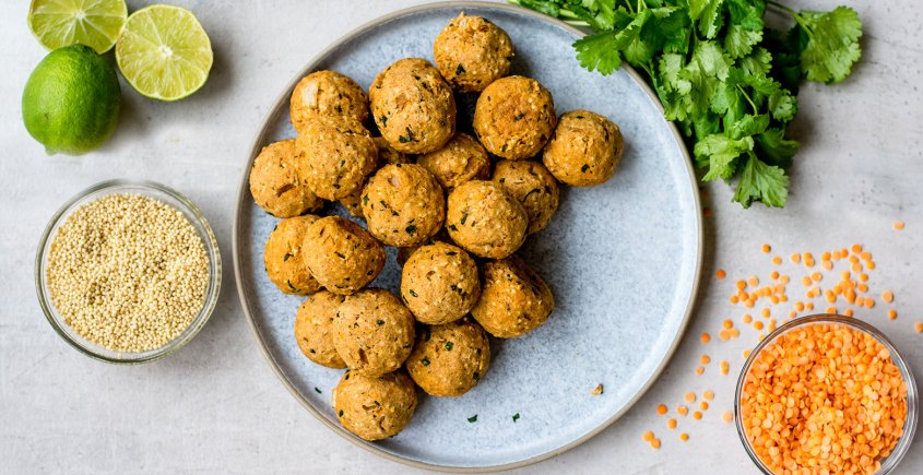 millet lentil balls on table with cilantro and limes