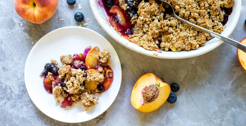 peach blueberry crisp on a plate