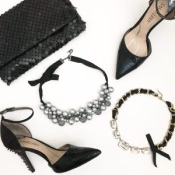 flatlay of women's accessories: necklaces, heels, clutch