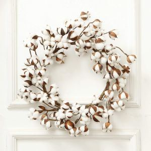 cotton-wreath-hanging-on-white-door