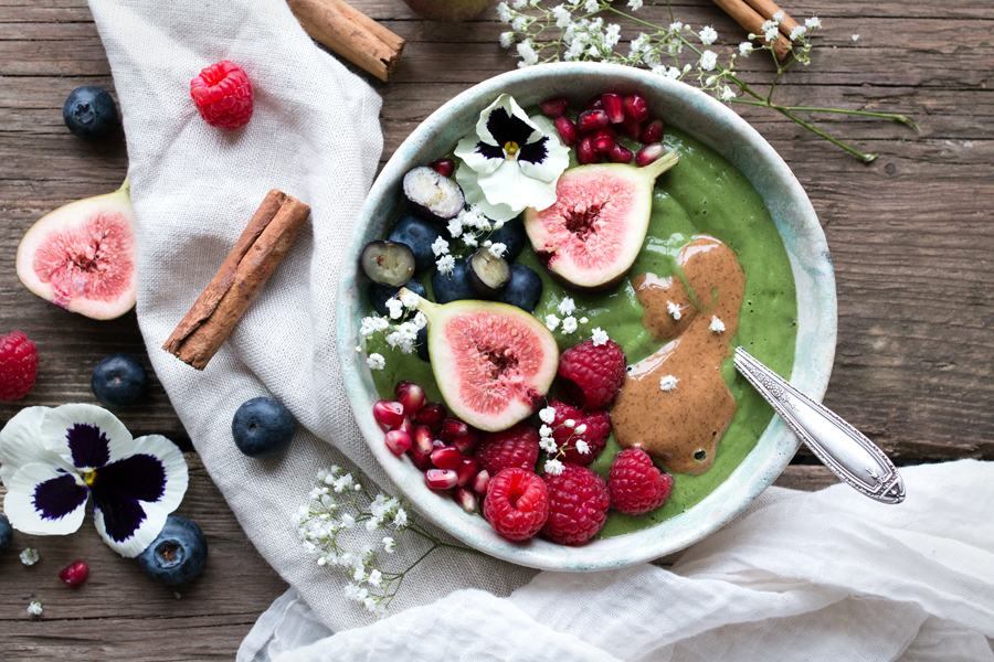 kale-smoothie-with-peaches-green-smoothie-in-bowl-with-berries-and-fruit