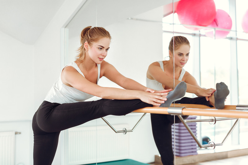 woman-stretching-on-ballet-barre