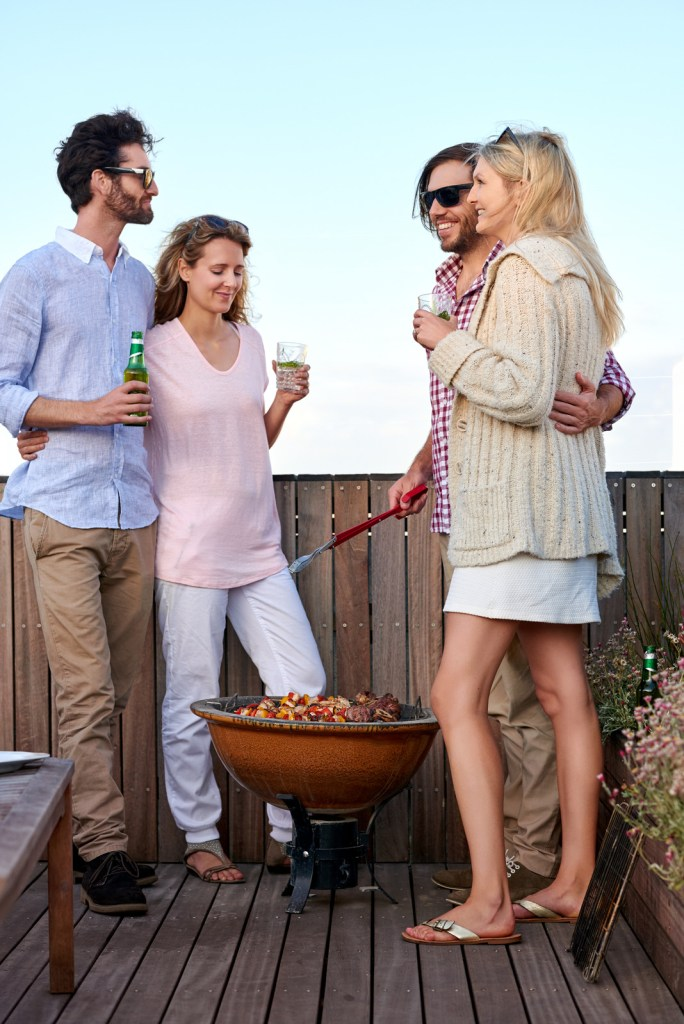 make-new-friends-couples-having-barbecue-on-the-outdoor-rooftop-terrace