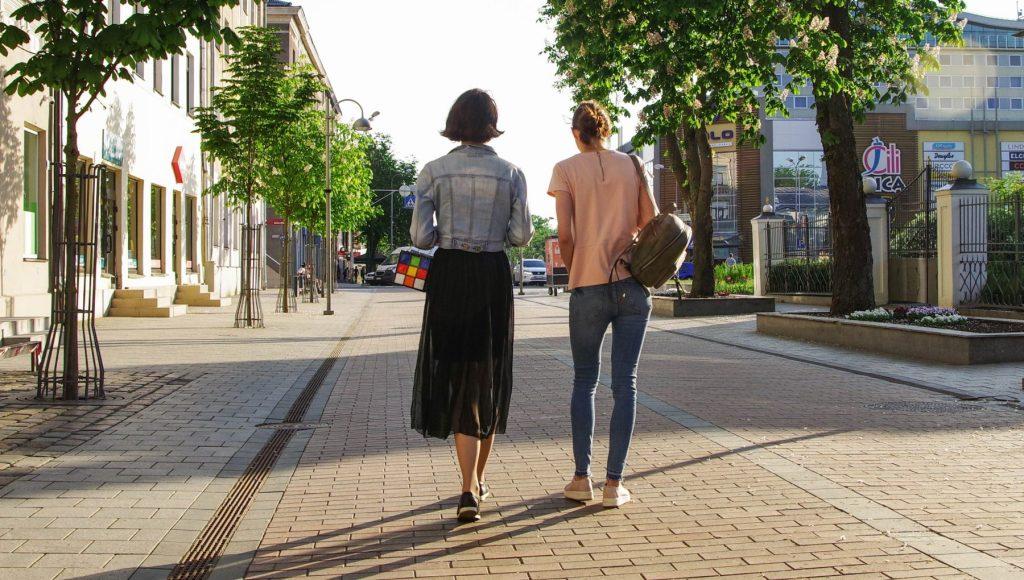 women-walking-down-street