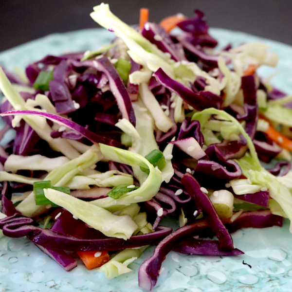 Low Carb Cabbage Slaw | Meat Free Keto - This tangy low carb vegan cabbage slaw gets it's flavor from tamari and ginger, making it a delicious and unique addition to any bbq or picnic!