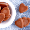 a bowl of heart shaped fat bombs with three on the side