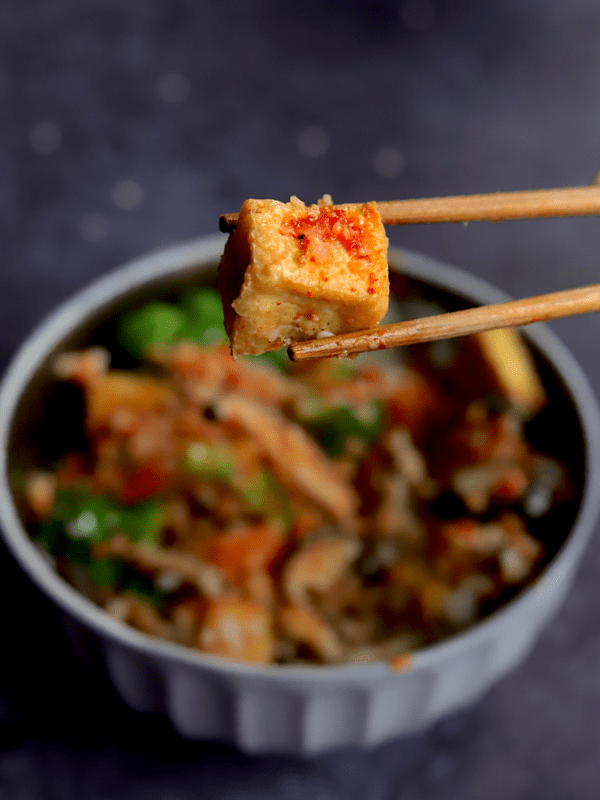 a closeup of a bite of gochujang tofu