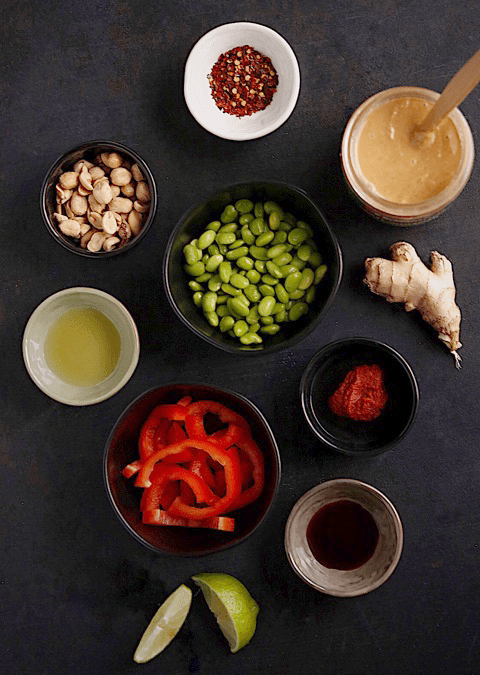 ingredients for making thai red curry shirataki noodles with peanuts, lime, ginger, red pepper flakes and edamame