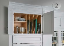 A deep wall cabinet with a split opening accommodates vertical storage and bulky items too!