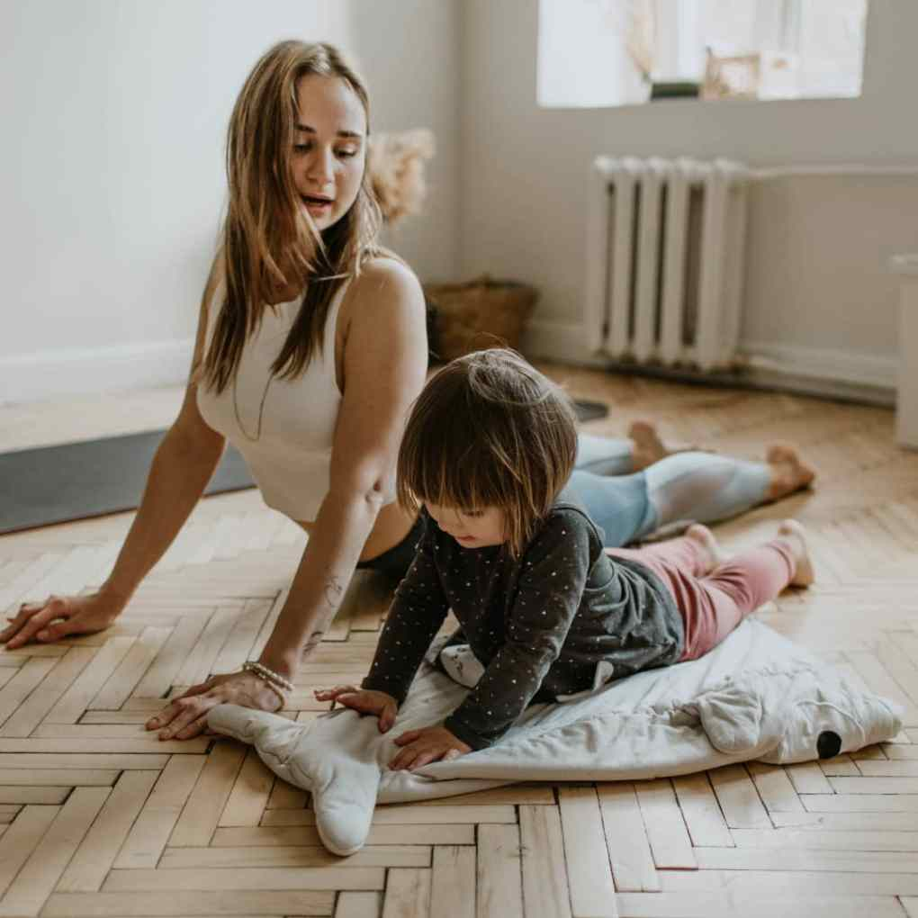 Home workout by mother and toddler