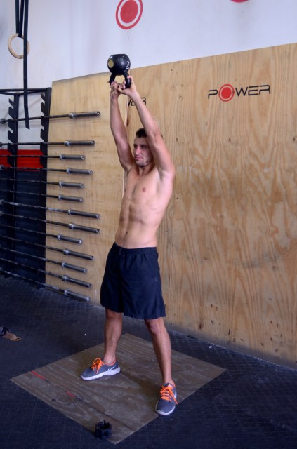 Athlete doing kettlebell swings