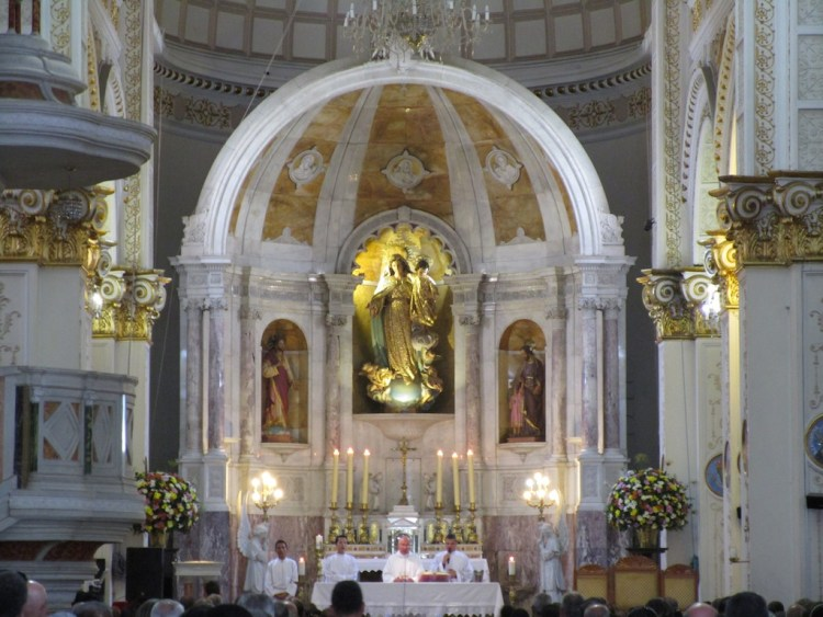 The main altar inside the church during mass