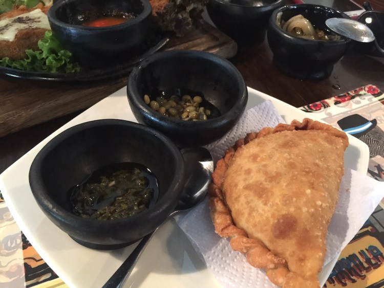 Meat empanada with marinated lentils and chimichurri