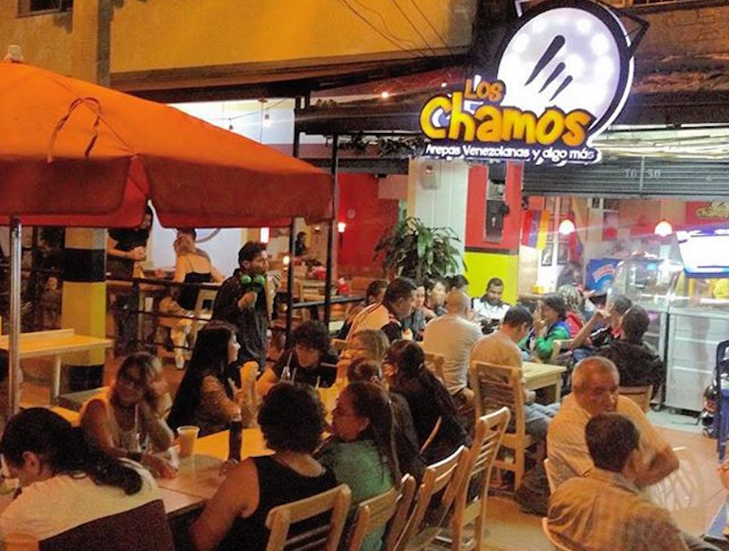 Los Chamos at night with sign