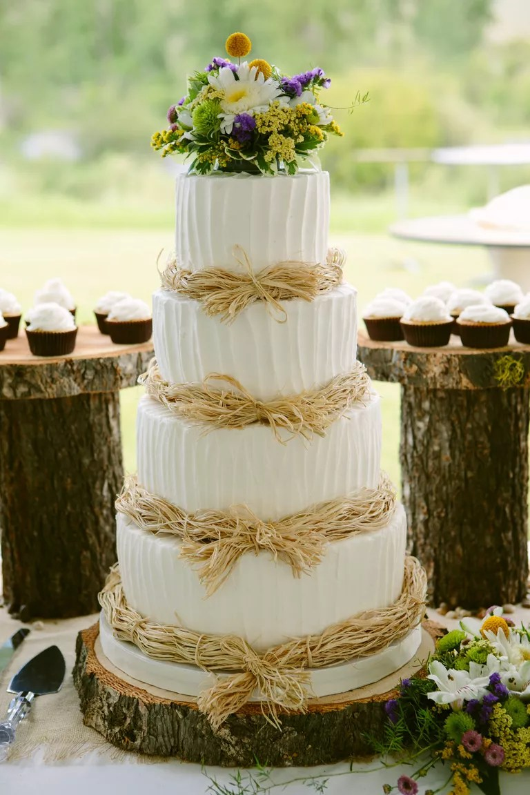 7 Beautiful Buttercream Frosted Wedding Cakes White wedding cake with buttercream frosting and fresh flowers