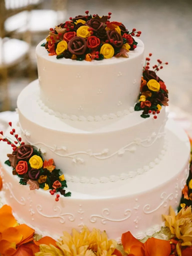 17 Gorgeous Fall Wedding Cakes Fall wedding cake with red  orange and yellow buttercream roses