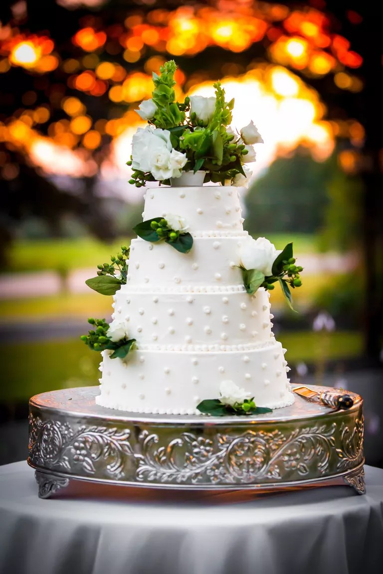 7 Beautiful Buttercream Frosted Wedding Cakes White buttercream wedding cake with Swiss dot design