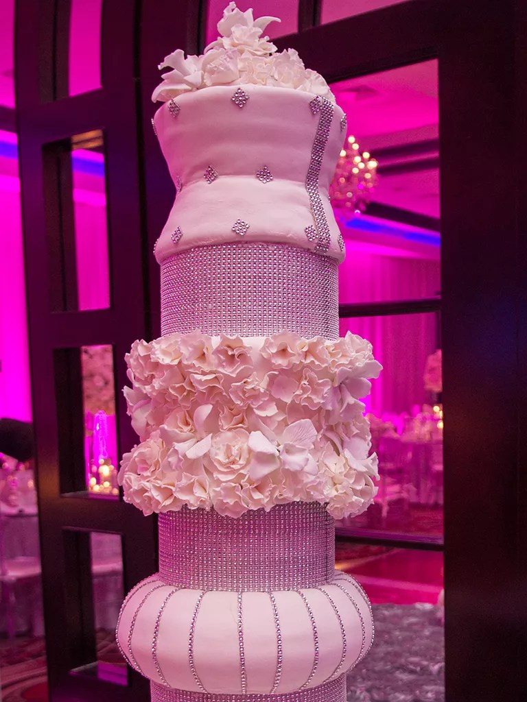 18 Wedding Cakes With Bling That Steal the Show Tall Wedding Cake With Crystal Covered Tiers and Sugar Flowers