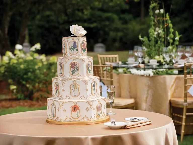 Wedding Cake  How Much Do Wedding Cakes Cost  Ornate cake with gold trim