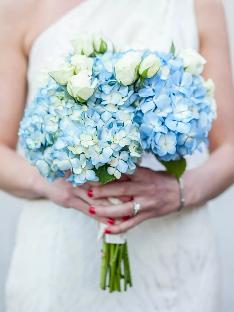 The Best Blue Wedding Flowers  and 16 Gorgeous Blue Bouquets  Blue and white wedding bouquet with roses and hydrangea