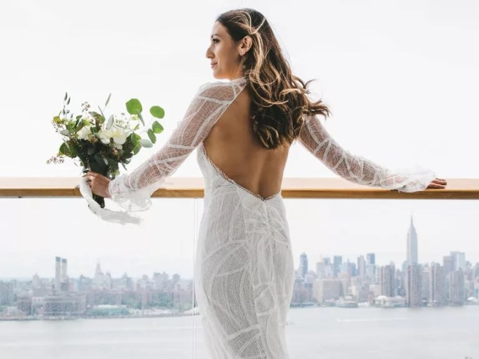Everything You Need to Know About Wedding Dress Alterations fitted wedding dress with open back detail