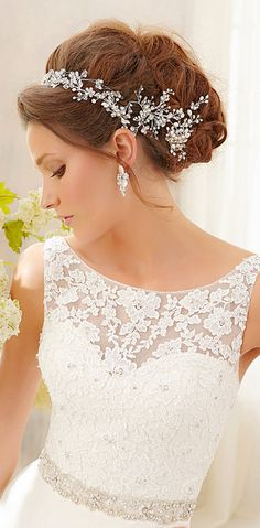 wedding dress. Love the lace on top. I'm not too crazy about the headpiece though