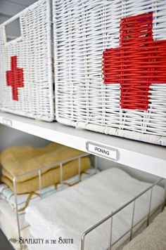 first aid basket - linen closet organization. great idea for babysitters to locate medicines quickly.