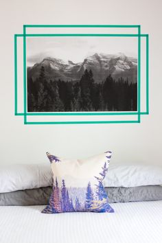 Why not make a faux frame for a lightweight piece of art with colorful tape? (actually, I like the pillow too)