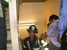 WTC September 11 2001. Everyone else going down the stairs. Firefighters walking up.