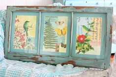 DIY:  Pictures from an old calendar were framed onto this salvaged window.  This post links to a blog that has a great DIY.