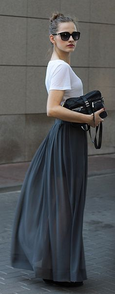 This black maxi skirt pairs perfectly with a simple white tee for a feminine yet edgy look.
