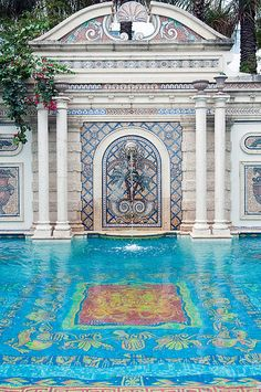 Blue mosaic tiles in the pool of the art deco Versace mansion, Casa Casuarina, on Ocean Drive, South Beach, Miami, Florida