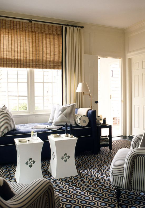 Cream walls and drapes and a toned down blue and beige color palette works perfectly because of the pattern play and the bold rug and daybed choices.