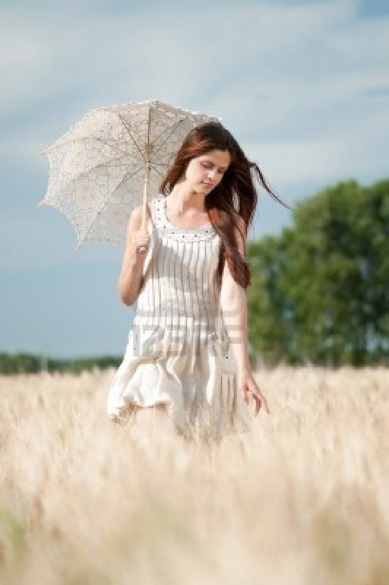 Image detail for -Beautiful sad and lonely woman with umbrella walking in wheat field ...  www.123rt.com