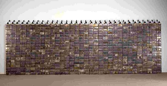 Christian Boltanski|Les archives de C.B. (C. Boltanski Archives)- 1965-1988, 1989. Installation with light.  Metal, photographs, lamps, electric wire. 270 x 693 x 35.5 cm.  646 biscuit tins containing approximately 1,200 photographs and 800 miscellaneous documents, under 34 lamps and electric wire.
