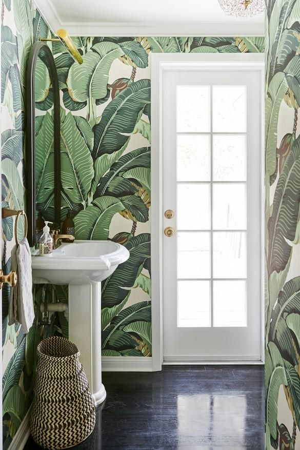 proof that all bathrooms should be layered in banana leaf wallpaper