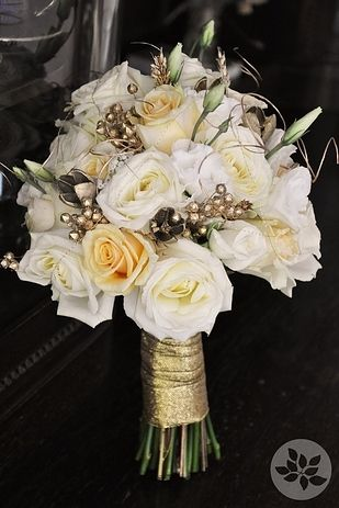 I actually really like this bouquet. It's not completely white. There's just enough golds, greens, and yellows to keep it interesting