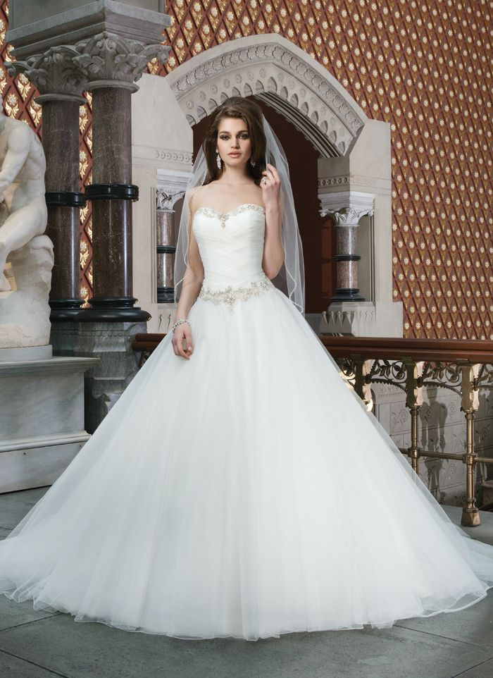 "JUST ARRIVED!!! ""Danielle"" by Justin Alexander  style 8716 Tulle ball gown features a chevron draped sweetheart bodice accented  with beading at the neckline and the basque waist. Gown has a lace up  back and chapel length train."