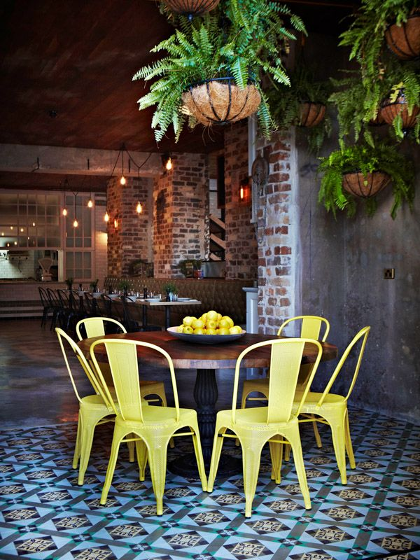yellow tolix chairs - perfect for outdoor dining