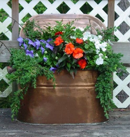 copper boiler with flowers for a wedding  | Walk in the Countryside: Copper Boiling Pots