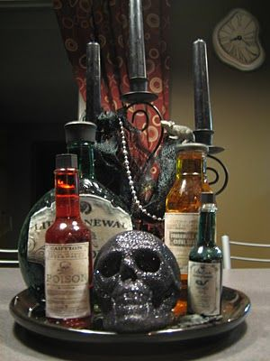 Halloween bottles and potions...inspiration for candy station with.cool containers for guests.to.take.candy.bags home.