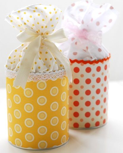 Cute small gift packaging- Tin can covered in fabric or paper, fabric glued to inside top of can and tied off with a bow!