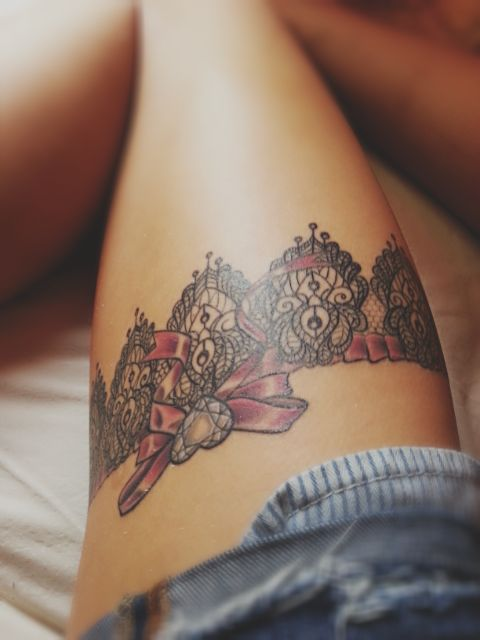 Garter tattoo..i love these type of tattoos. If I had the body for it I would totally have one and I would get the exact garter tattooed on me that I wore on my wedding day