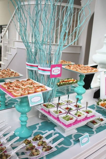 Love the bright colors in this wedding reception appetizer display. The candlestick plate holders with colored paper are genius.