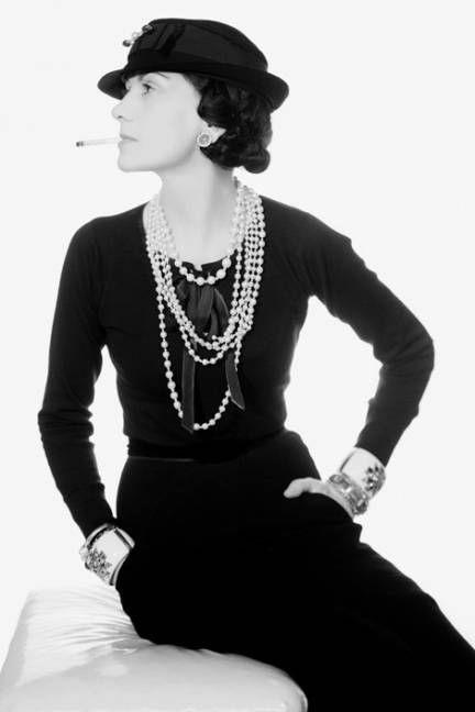 Coco Chanel photographed by Man Ray wearing the Maltese Cross cuffs made for her by Duke Fulco di Verdura.
