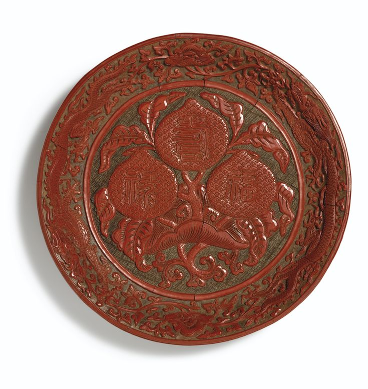 A very rare carved cinnabar lacquer circular dish, Mark and period of Jiajing