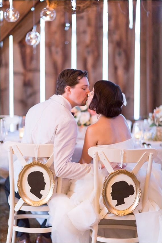 Decorate chairbacks at your wedding with silhouette chair signs!  The signs can be re-used after the wedding as home decor.   Photo by Olivia Smartt, signs by Crafted By Kerstin.
